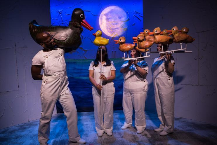 Duck puppets and puppeteers