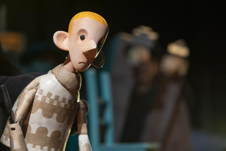 a male puppet on stage